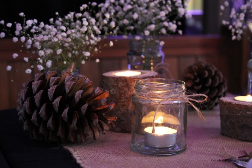 Jam Jar tealights, gypsophila, and pine cones