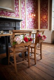 Chairs with flowers at No 4 Clifton Village- Elizabeth Weddings
