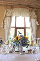 Blue and yellow floral centrepiece- Styling by Elizabeth Weddings