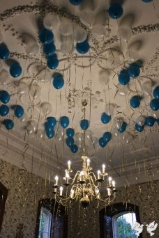 Turquoise, white and gold helium balloons in the Oak room- Styling by Elizabeth Weddings