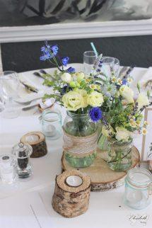 Rustic, natural, log centrepiece with jam jar flowers- Styling by Elizabeth Weddings