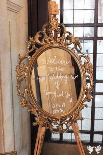 Gold ornate mirrored frame- Styling by Elizabeth Weddings