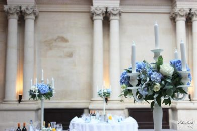 Ivory candelabra as centrepiece with floral rings -Styling by Elizabeth Weddings