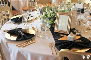 Art deco Styling with Gold charger plates and Black napkins- Elizabeth Weddings