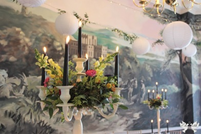 Monochrome and brights on ivory candelabra, styling by Elizabeth Weddings