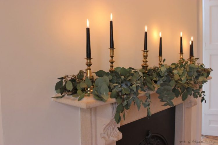 Black, gold brass candlesticks and foliage, by Elizabeth Weddings
