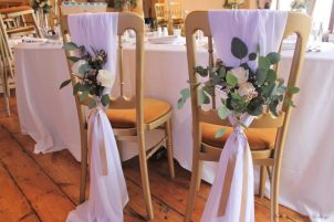 Floral and chiffon backed chairs, styling by Elizabeth Weddings