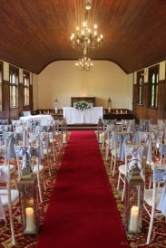 Ceremony and grey sashes at Stancliffe Hall, styling by Elizabeth Weddings