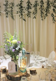 Rustic, natural, gin bottles and foliage centrepiece, styling by Elizabeth Weddings