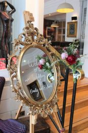 Gold ornate oval frame, styling by Elizabeth Weddings