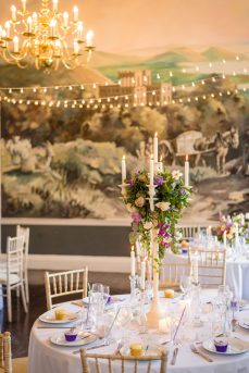Purple and ivory candelabras, by Elizabeth Weddings