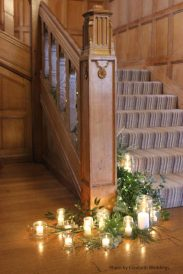 Candles and foliage at Coombe Lodge, styling by Elizabeth Weddings