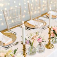 Brass candlesticks and gold charger plates, styling by Elizabeth Weddings