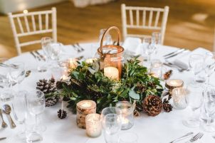 Wintry, foliage and pine cone centrepiece, styling by Elizabeth Weddings