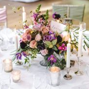 Pink and purple urn centrepiece, styling by Elizabeth Weddings