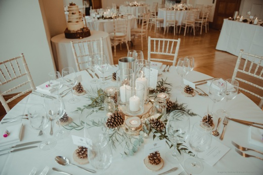 Rustic, candles, pinecones, log slice centrepiece, styling by Elizabeth Weddings