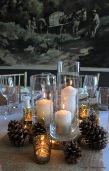 Candles in glass vases, pine cones and rustic styling, styling by Elizabeth Weddings