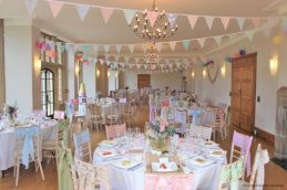 Pastel bunting, pastel sashes and rustic decor, styling by Elizabeth Weddings