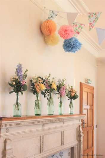 Pastel flowers in Vintage bottles, styling by Elizabeth Weddings