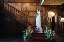 Staircase flowers and candles, Elizabeth Weddings